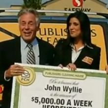 When John Wylie received his Big Check, what did he say he was going to buy his father?