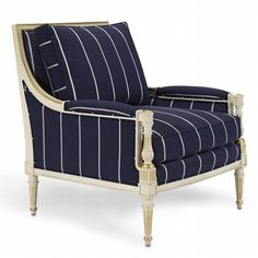 """This Louis XVI style chair has nailhead borders, fluted legs and gold leaf accents.  Dimensions:  W32"""" x D32 1/2"""" x H36 1/2""""  Arm Height: 23""""  Arm Width: 2 1/2""""  Seat Height: 18""""  Sitting Depth: 24""""  Between Arms: 26"""""""