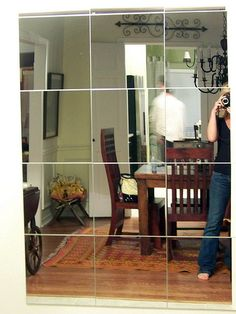 Big mirror made out of 12x12 mirrors...wonder what it'd look like with black trim between each one?