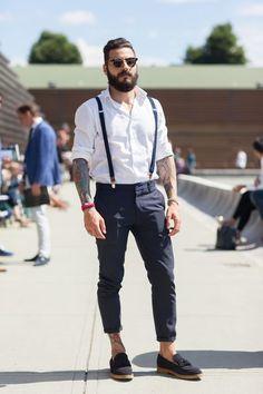 Shop this look on Lookastic: http://lookastic.com/men/looks/sunglasses-longsleeve-shirt-suspenders-chinos-tassel-loafers/7128 — Dark Brown Sunglasses — White Long Sleeve Shirt — Navy Suspenders — Navy Chinos — Black Suede Tassel Loafers