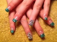 Full set of acrylic with glitter dust and Swarovski crystals on ring finger...