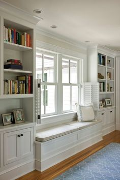 A window seat and built-ins connect the remodeled original bedrooms with the new master suite.