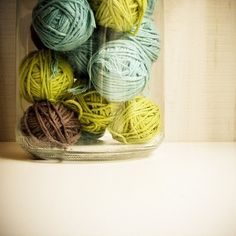 Bailey and Sonia: decorate with your leftovers:  An easy and inexpensive way to add color and texture to a room—balls of yarn or twine in in a glass jar or vase.