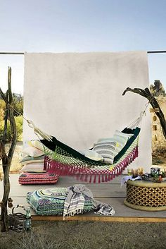 January 2015 Designer Insider: Dreaming of warm weather? So am I! Anthropologie's Canyon Fringe Hammock is perfect for a sunny day with a book and a glass of lemonade! CamiDesigns.com #camiweinstein #camidesigns #interiordesign #outdoor #hammock #anthropologie #summertime #summer #outdoors #backyard #lounging #picnic #design #interiordesignblogger #blogger #designblogger #trending #bohemian #artsy #chic #fashion #style #home