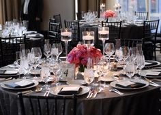 black napkins? im envisioning white table clothes, pink runner, black napkins. white chair covers with black cloth tied really cutly around them ? I think you could totally stick some birch twigs in the center pieces if you wanted!