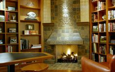 Stone fireplace serves as focal point for this lovely library.