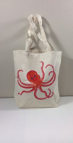 A personal favorite from my Etsy shop https://www.etsy.com/listing/237701328/tote-bag-with-hand-painted-red-octopus love it