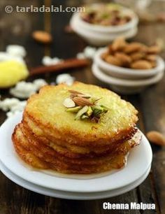 Chenna Malpua ( Rajasthani- Chenna Malpua ( Rajasthani Chenna Malpua, delicate and lacy malpuas made using fresh paneer which will melt in your mouth.Serve them warm topped with rabri or just garnished with chopped almonds and pistachios. Indian Dessert Recipes, Indian Sweets, Indian Recipes, Rajasthani Food, Rajasthani Recipes, Delicious Desserts, Yummy Food, Tandoori Masala, Desi Food