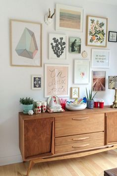 A pretty and inspiring gallery wall in Teen Vogue, featuring our partner Rifle Paper Co. Love the soft pastels and midcentury modern console.