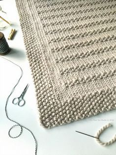 """""""Stones in the Road"""" blanket knitting pattern by Fifty Four Ten Studio. Easy to knit blanket pattern using super bulky yarn. Chunky & cozy! Instructions for five sizes including XL afghan, large throw, medium throw, small crib/lap blanket and baby blanket."""