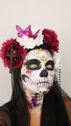 Sugar Skull Halloween Makeup. I like how this one trails down the neck