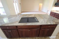 It's the perfect stove! A jennaire cooktop on this marble island! Kitchen Island, Kitchen Cabinets, Marble Island, Interior Work, Florida Living, New Home Builders, Custom Homes, Stove, Beautiful Homes