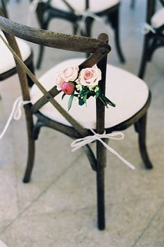X-Back Chair - A Tuscan style chair with a natural wood finish and a signature cross-back design. This chair embodies rustic elegance and is a popular choice for sophisticated weddings set at farms, barns, or vineyards. {Photo by Julie Cate Photography} Follow @weddingwire for more inspiration!