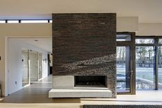 light and space around fireplace - house at the edge of a forest by hilberink bosch architects.
