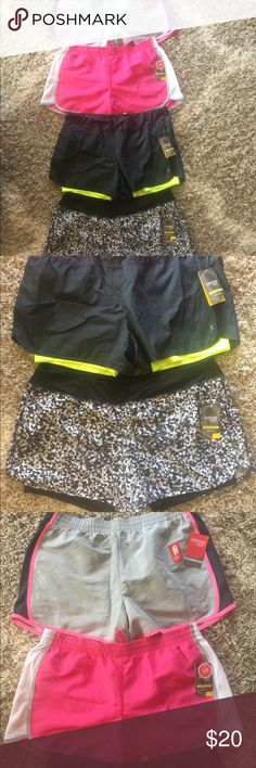 Danskin Athletic Shorts, size Large ~New~ Danskin Athletic Shorts, size Large, all are new with tags. Top two pairs have underwear liner, retail $6.96. Bottom two lakes have spandex short liner, retail $9.86.  Check out my closet for other listings, bundle and save!  Looks good with Nike, Under Armour, Adidas, ASICS and Reebok. Danskin Shorts