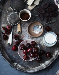 Homemade chocolate pudding plus fresh cherries.