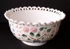 """An outstanding bowl with openwork edge and a daisy and leaf pattern on the inside-bottom of the bowl. Painted in shades of blue, green & pink. By Challinor, Taylor. 1885 - 1893. Shown in Belknap, """"Milk Glass"""", page 122.  Size: 8 1/4"""" diameter; 4"""" high"""