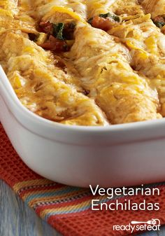 Refried beans, zesty tomatoes, chopped spinach, corn and cheese makes a flavorful filling for vegetarian enchiladas Vegetarian Enchiladas, Bean Enchiladas, Vegetarian Recipes Dinner, Dinner Recipes, Tostadas, Tacos, Burritos, Pita, Thin Crust Pizza