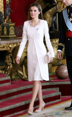 Fit for a Queen from Queen Letizia of Spain's Best Looks  Queen Letizia of Spain looks every bit the part in this white crystal embellished coat by designer Felipe Varela during King Felipe VI's coronation ceremony, her first official event in her new title.