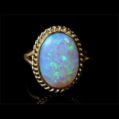 Fabulous 6ct Colourful Opal Gold Ring by LaurelleLtd on Etsy https://www.etsy.com/listing/267952932/fabulous-6ct-colourful-opal-gold-ring