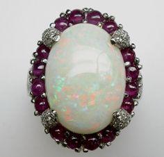 Da easyoro anello in oro bianco con diamanti, rubini e opale!