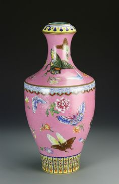 China, 18th/1th C., rare pink Famille Rose vase, inverted soft edged rim, tapering sides to high footed base, artfully decorated throughout featuring flying insects with peonies, three borders dividing the rim, neck and foot in Ruyi design with gilt edging, six character Qianlong mark on turquoise base.