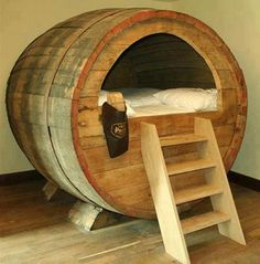 Very unusual bed :D , who wants to sleep there ?