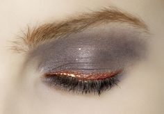 Grey brown eyeshadow with copper gold liner