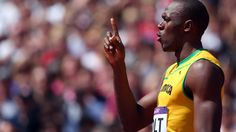 Usain Bolt celebrates cruising through the first heat of the 100 metres  London 2012