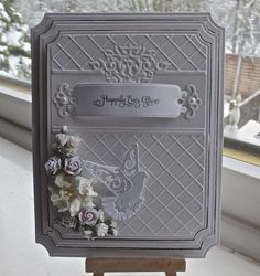 Hi everyone Todays card I have used spellbinders grand large labels as my base card and then added another 2 layers which I have matted in silver. With the top layer I also embossed it using sizzix...