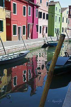 ✯ The traditional brightly painted homes in the small fishing village of Burano, Italy are mirrored in the canal waters