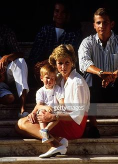 Princess Diana Princess of Wales holds Prince Harry whilst on holiday in Majorca Spain on August 1988 Also present were the Spanish Royal Family and...
