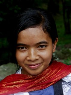 Young girl selling scarves outside temple, Siem Reap, Cambodia