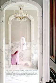 taupe against white marble, chandelier, touch of pink