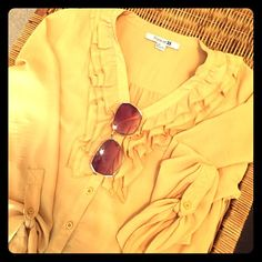 [Forever 21] Yellow ruffle top Easy to dress up or down. Buttons down the front and on sleeves. 100% polyester   Never worn Forever 21 Tops