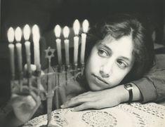 Girl admiring Hanukkah candles, USA, 1970s | BH Open Databases