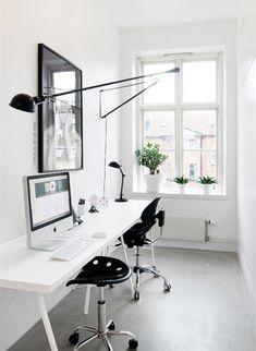 super sleek black and white minimalist work space