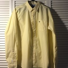 Dress Shirt American Eagle Yellow stripped dressed button down shirt. Like new no tears or stains. Fits well on a mens L. American Eagle Outfitters Tops Button Down Shirts