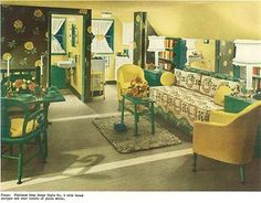 Another 1940s studio apartment--  You hardly notice the sloped ceiling due to a masterful visual trick — using a dark and bold wallpaper to accent the straight and tall walls at the end of the room — and painting the slanted portion of the ceiling a light-reflecting cheery yellow. Keeping the color scheme simple also unifies the various functional spaces and makes the room feel larger than it is.