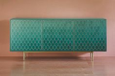 Gorgeous. Could use wallpaper and gold paint to makeover Ikea Stockholm sideboard.  Shamsian collection