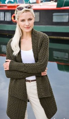 The Waterfall Cable Cardigan is knitted in a 100% merino wool marled yarn...blending forest green and grey yarn together in the knitting.  A longer style option with the front with a double breasted waterfall collar. This gorgeous cardi has a relaxed style yet fitted shape, making it the perfect layering piece for any outfit.