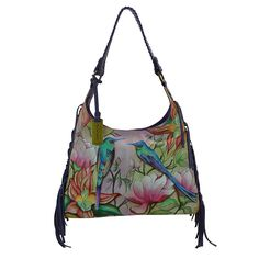 Be the envy of all your friends with this gorgeous Handbag .  Made from the finest and softest leather and delicately hand painted by the finest artists, paying close attention to detail.  It features a soft luxurious fringe on the sides and has a removable cosmetic pouch and optical case.   Hand Painted.  Genuine Leather.  Top zip entry.  Inside one zippered compartment, one open pocket, two multipurpose pockets.  Rear zippered compartment, slip in pocket.  Removable cosmetic pouch and…
