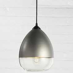 Inspired by the literal fluid beauty of a languid droplet, the Hennepin Made Teardrop Pendant merges the flawless clarity of handblown glass with the burnished metallics of spun aluminum. The top of the delicate drop subsumes much of the glass portion of the shade, with the tip of a tubular incandescent bulb (included) slightly peeking out like the sun after a summer rain (or, ummm, cry). Teardrop is part of Hennepin