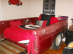 made this for my sons christmas present he is autistic and loves trucks so we bought the bed of a truck from the junk yard and brought it into his room and made it into his bed along with tires and all.