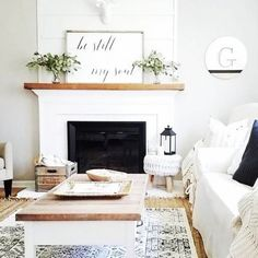 You have to see this #farmhouse living room decor idea with a rustic coffee table and mantel decor. Love it! #RusticDecor #HomeDecorIdeas