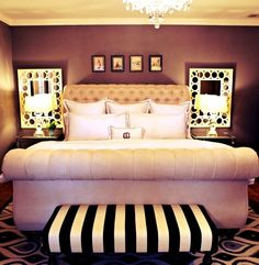Mirrors behind the bedside lamps. Doubles the light in the room........ Love log the couch!!!