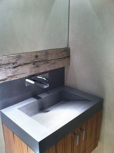 This #concrete #sink was placed into a transitional apartment in Battery Park NYC.  The Vallum sink by Trueform Concrete was paired along side a beautiful strip of reclaimed lumber.  This was a beautiful combination of materials by Brooke Morales. #TrueformConcrete #OurSinks