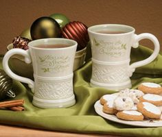"""Gaelic Greetings mug pairs striking Celtic knot work and Gaelic sentiments-with a striking holiday flair! Uniquely shaped mug is crafted of oven/microwave/ dishwasher safe stoneware. 4 ½""""H. Christmas In Ireland, Irish Christmas, Christmas Mugs, Irish Girls, Auction Items, Stoneware, Hand Painted, Tableware, Happy"""