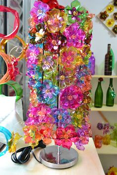 like the colors and clear shininess..  made of plastic bottles?  pet flowers lampshade