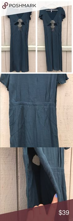 Free people dress Used only once.Really cute cotton material.Dark teal green color,with some cutouts in the front of the dress. Free People Dresses Midi